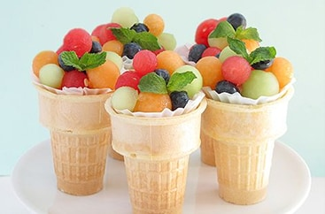 Fruit salad in ice cream cones